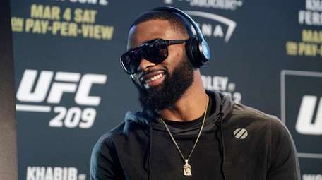Tyron Woodley speaks with the media during a