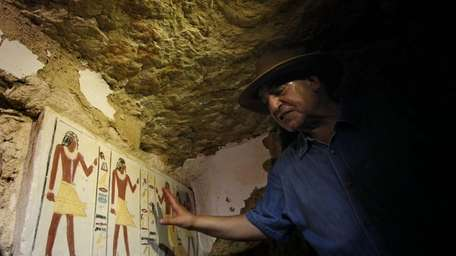 Egyptian Antiquities chief Zahi Hawass shows to the