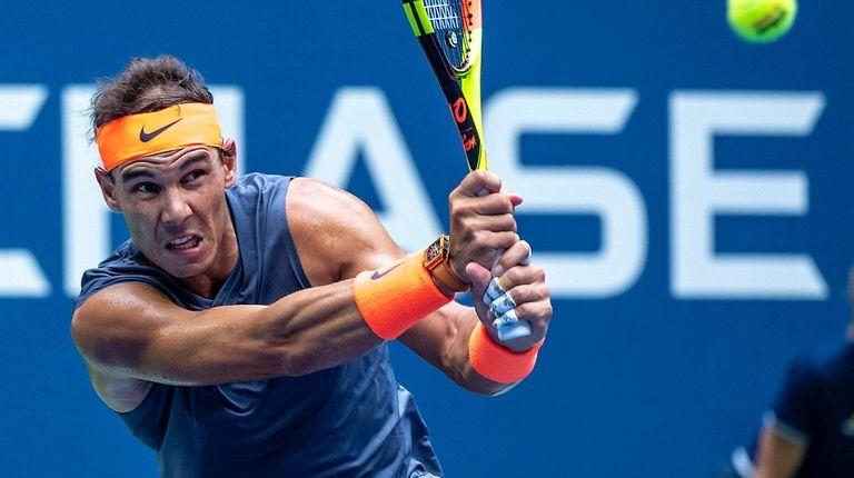 Rafael Nadal of Spain hitting a backhand against