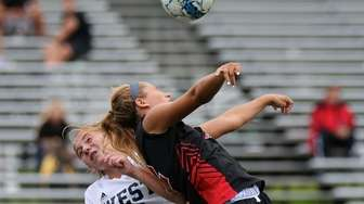 Hills East's Jessica Garziano takes a hit to