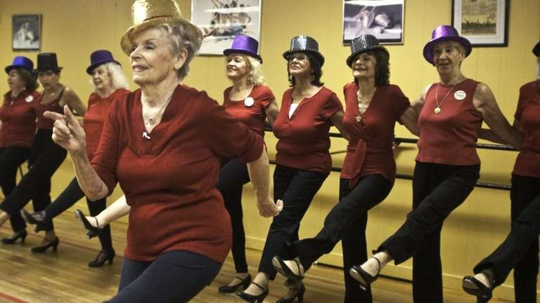 Corliss Whitney leads her dance troupe, the Seasoned
