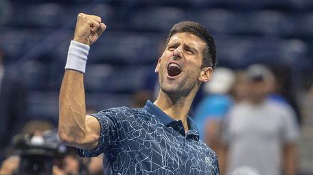Novak Djokovic of Serbia reacts after defeating Kei