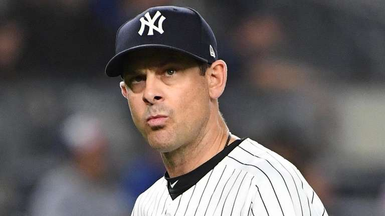 New York Yankees manager Aaron Boone walks to