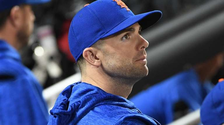 Mets captain David Wright watches Friday night's game