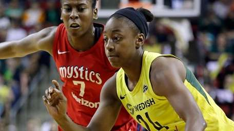 Seattle Storm's Jewell Loyd drives past Washington Mystics'