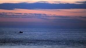 A fishing boat cruising during the early morning