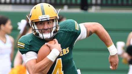 LIU Post quarterback Chris Laviano carries the football