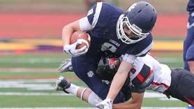 Northport's Tom Lauinger (8) runs the ball and