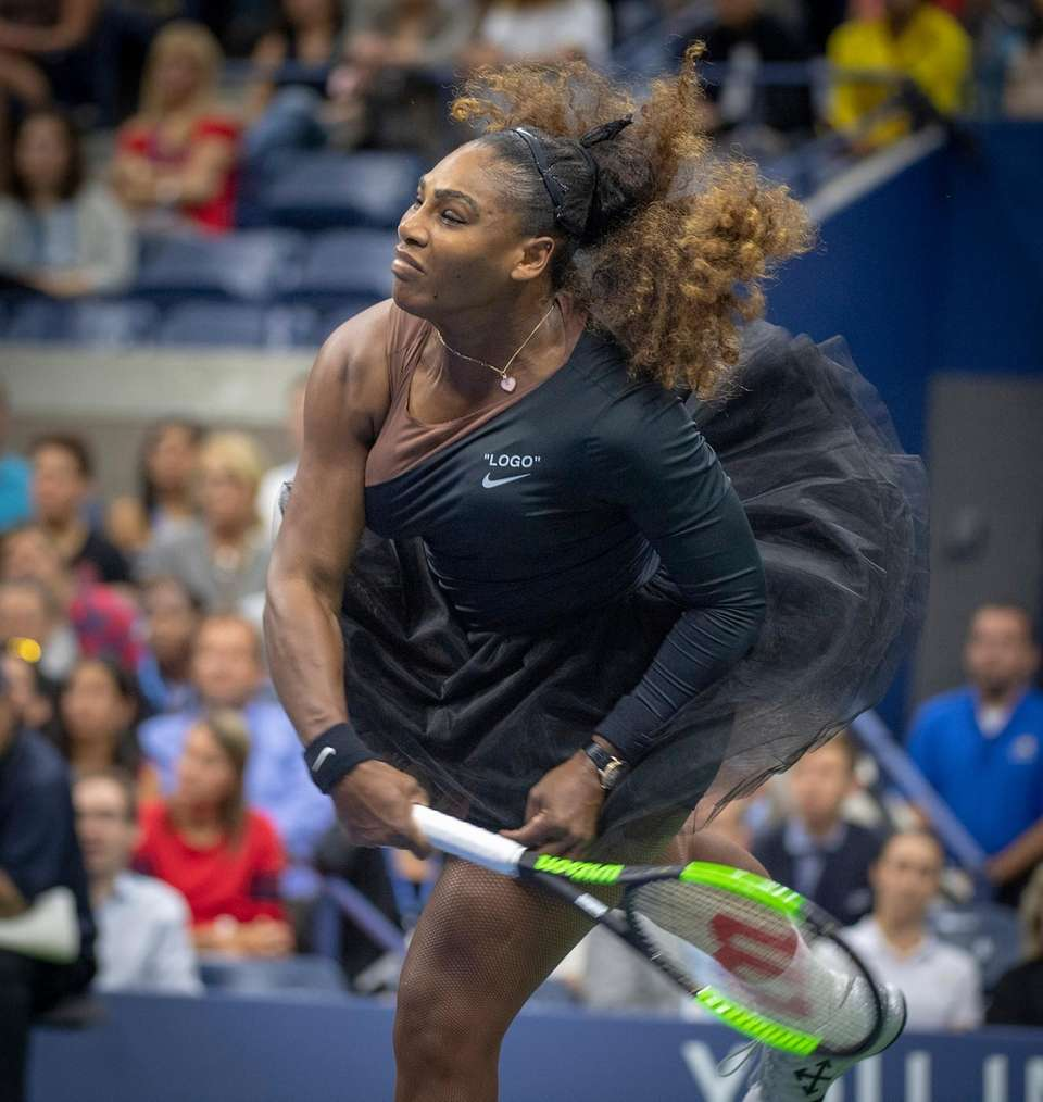 Serena Williams serving against Naomi Osaka during the