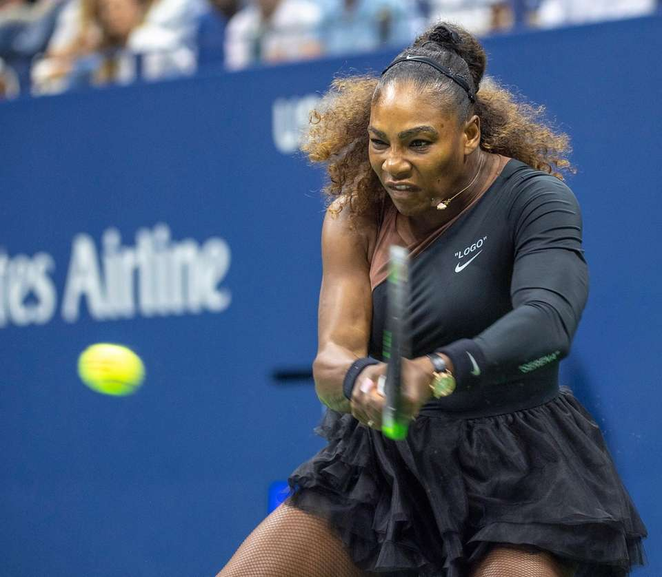Serena Williams hitting a backhand against Naomi Osaka