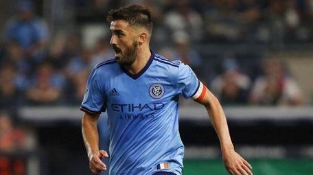 NYCFC forward David Villa moves the ball up