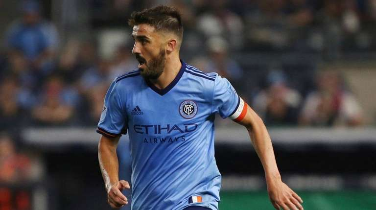 NYCFC forward David Villa moves the ball up