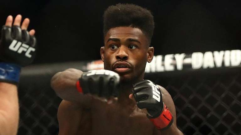 Aljamain Sterling punches Cody Stamann at UFC 228