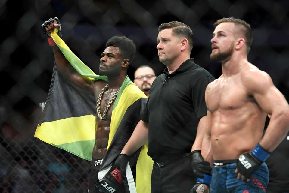 Aljamain Sterling, left, is acknowledged as the winner