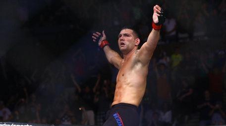 Middleweight Chris Weidman celebrates after defeating Kelvin Gastelum
