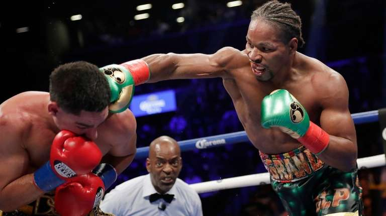 Shawn Porter, right, punches Danny Garcia during the