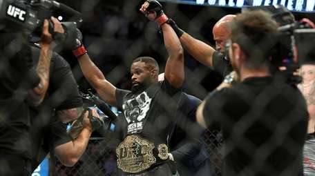 Tyron Woodley is acknowledged as the winner after