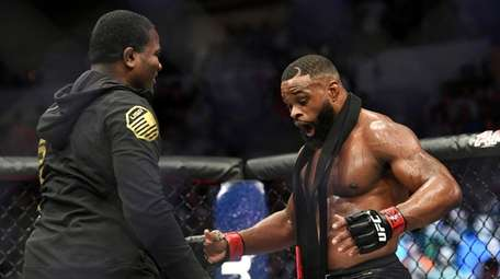 Tyron Woodley, right, reacts after defeating Darren Till