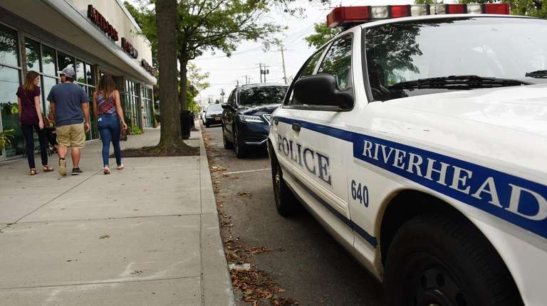 A Riverhead Town Police car is parked on