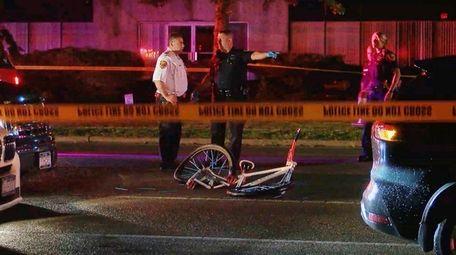 Suffolk County police investigate the scene where Davon