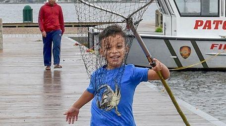 William Villatoro, 6, of Port Jefferson, runs in