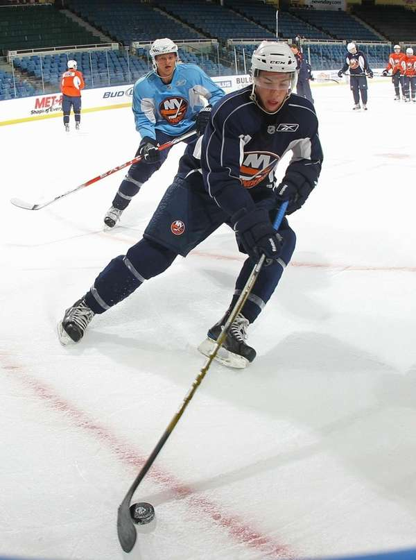 2009 second-round pick Travis Hamonic controls the puck