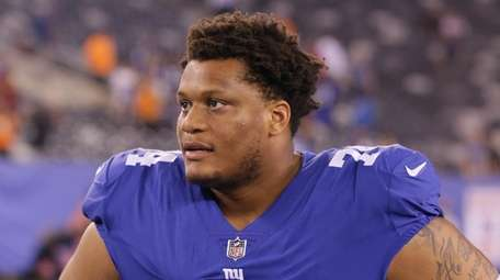 Giants offensive tackle Ereck Flowers looks on following