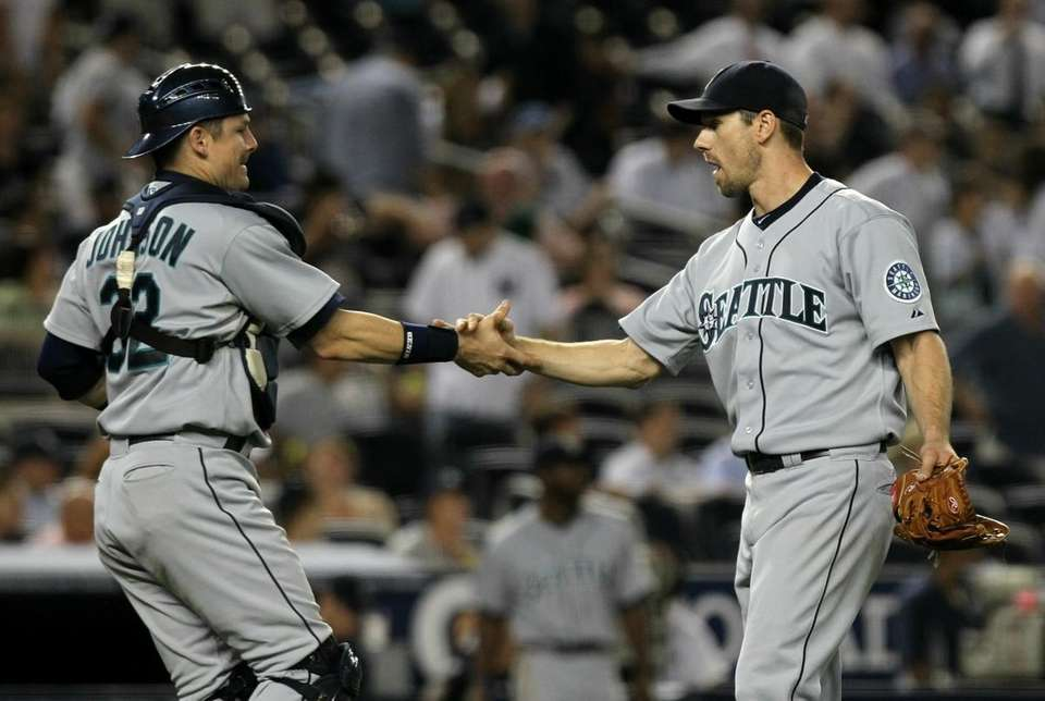 Seattle's Cliff Lee celebrates a win over the