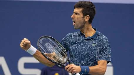 Novak Djokovic pumps himself up after winning a