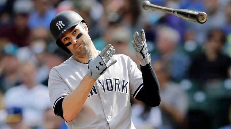 The Yankees' Neil Walker flips his bat after