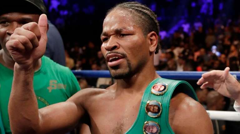 Shawn Porter gestures to supporters after a WBC