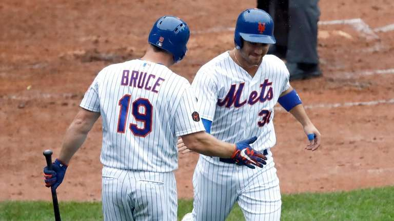 Mets rightfielder Jay Bruce greets leftfielder Michael Conforto