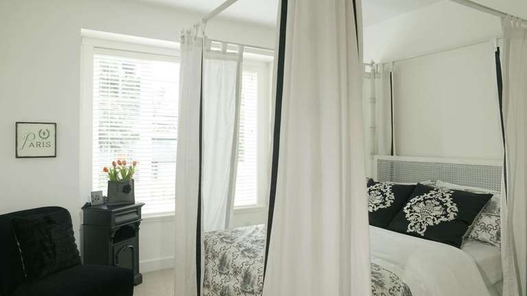 This all-white bedroom looks fabulous and restfully cool