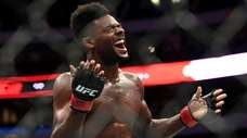 Aljamain Sterling celebrates after defeating Cody Stamann in
