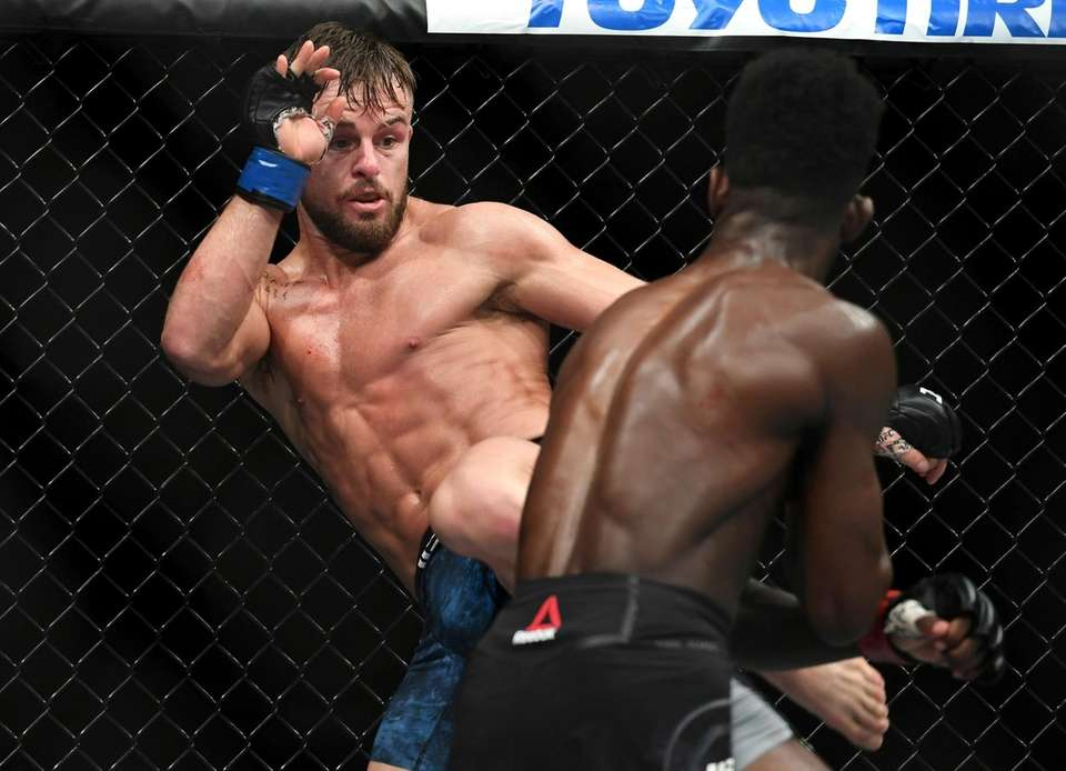 Cody Stamann, left, kicks Aljamain Sterling during their