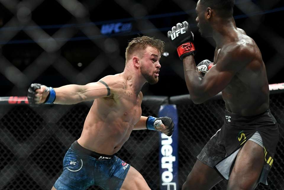 Cody Stamann, left, throws a punch at Aljamain
