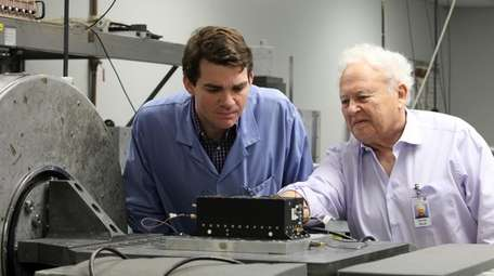 Chairman and chief scientist Martin Bloch, right, and