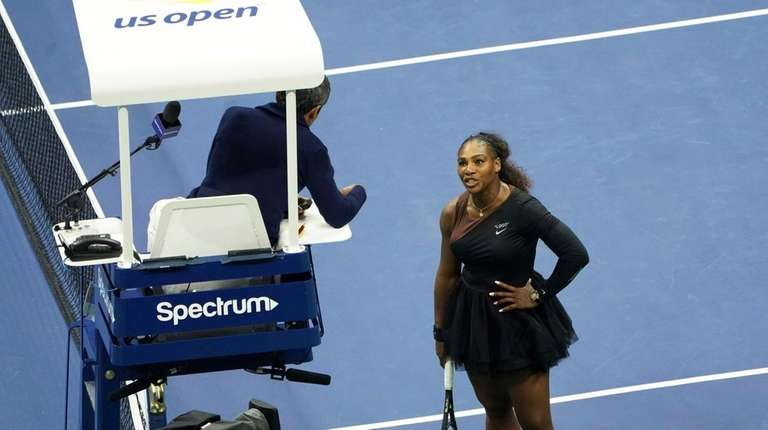 Serena Williams argues with the chair umpire during