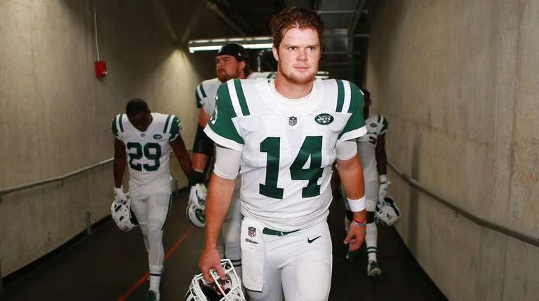 Sam Darnold of the Jets walks out of
