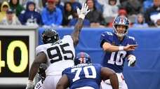 Eli Manning throws an interception that was returned