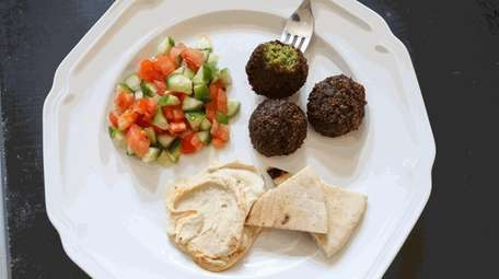 Falafel, Israeli salad, pita and hummus prepared by