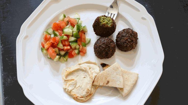 Falafel, Israeli salad, pita and hummus prepared by