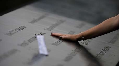 Families gather at the edge of the 9/11