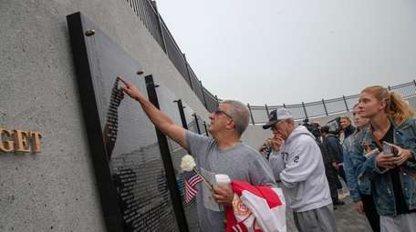 Matthew Graci at the memorial wall during the