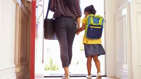 Mother and daughter leaving for school.