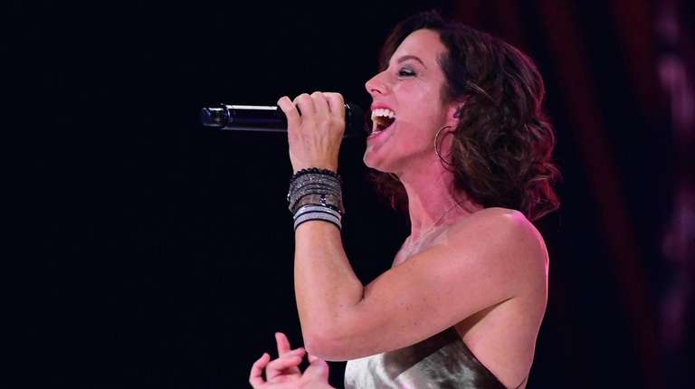Sarah McLachlan sings during the opening ceremony of