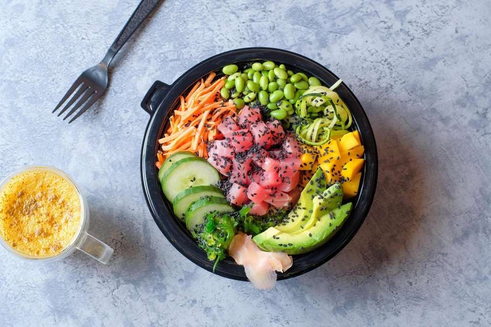A poke bowl comes with fresh tuna, avocado,