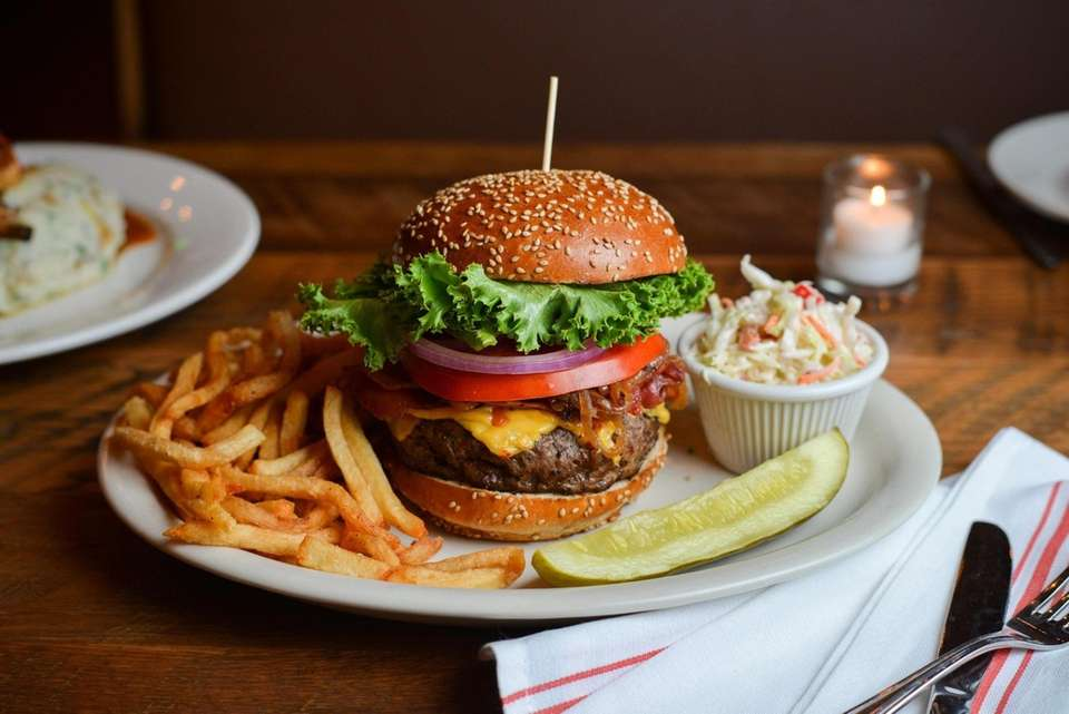 A chophouse burger stands tall at PeraBell Food