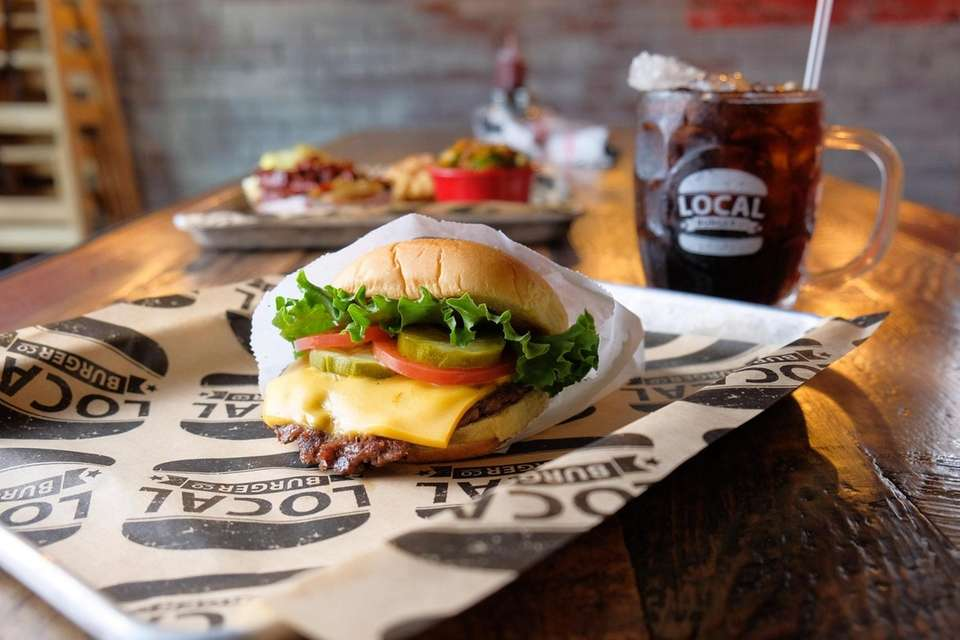 The Local Burger  features American cheese, lettuce,