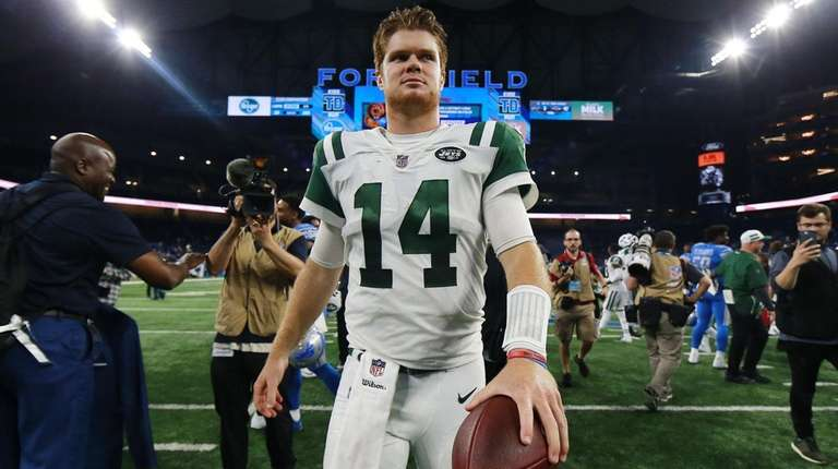 Sam Darnold of the Jets exits the field